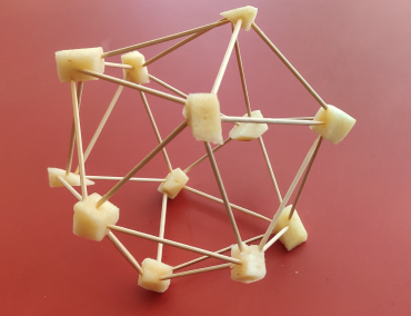 An icosahedron made of chopsticks and apple pieces.