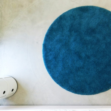 Concrete and blue carpet